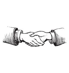 Two people shaking hands vintage engraving vector