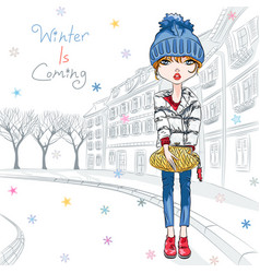 Fashion girl in winter clothes in old town vector