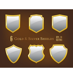 Collection of golden and silver shields vector