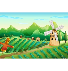 A farm with wooden houses and a scarecrow vector image vector image