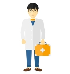 Doctor with first aid box vector