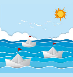 Origami boats sailing in the sea vector