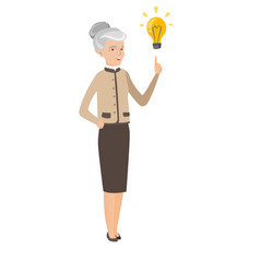 Caucasian business woman pointing at idea bulb vector