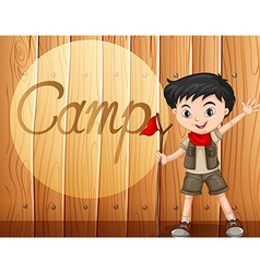 Boy in camping costume with walking stick vector