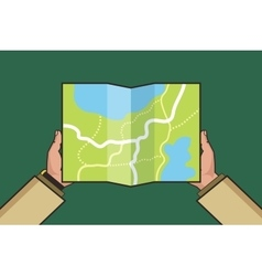 Hands holding paper map folded map in hands of vector