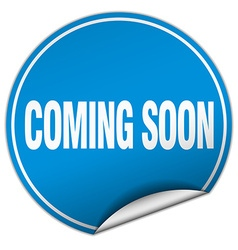 Coming soon round blue sticker isolated on white vector