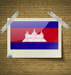 Flags cambodia at frame on a brick background vector