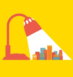 A big city under the light of a desk lamp vector