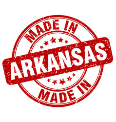 Made in arkansas red grunge round stamp vector