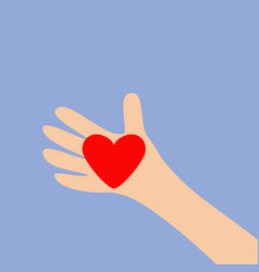 hand arm holding red shining heart shape sign vector image