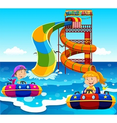 Boy and girl riding on water slide in the ocean vector