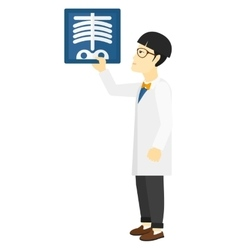Doctor holding radiograph vector image vector image