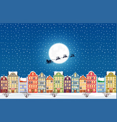 santa claus flies over a decorated snowy old city vector image vector image