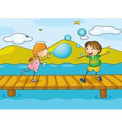 Kids playing at the bridge vector image