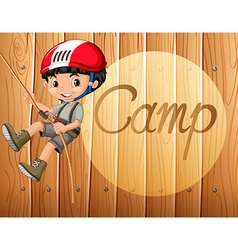Boy with helmet climbing up the rope vector image
