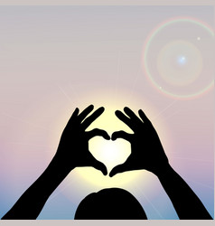 hand silhouettes forming a heart with sun inside vector image vector image