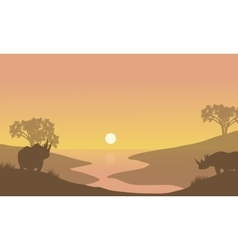 Rhino silhouette in riverbank vector