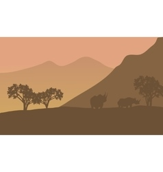 Rhino silhouette on the mountain vector