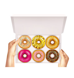 realistic donuts in box in hands vector image vector image