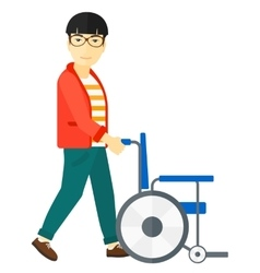 Man pushing wheelchair vector