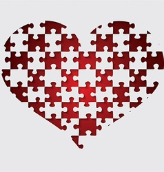 Cut out jigsaw heart in format vector