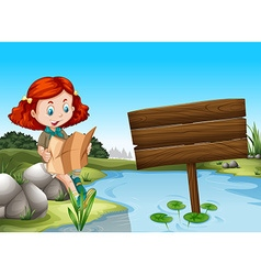 Girl reading map by the river vector