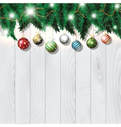 Christmas baubles on wood vector image
