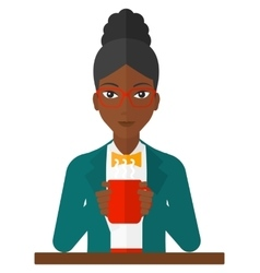 Woman sitting with cup of coffee vector