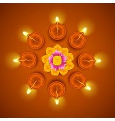 Decorated Diwali Diya on Flower Rangoli vector image vector image