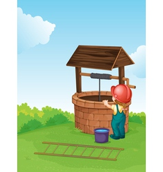 Worker by the well vector