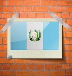 Flags guatemala scotch taped to a red brick wall vector