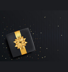 black gift box with ribbon and gold bow top view vector image
