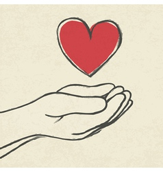 Heart in hands vector