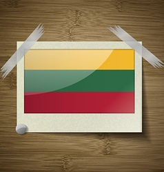 Flags lithuania at frame on wooden texture vector