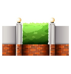 Brick fence and green bush vector