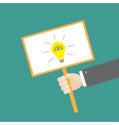 Businessman hand holding idea card light bulb vector