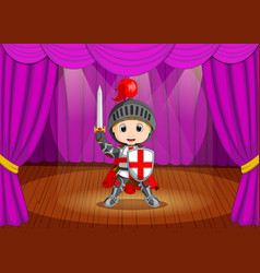 cute little boy wearing knight costume on stage vector image