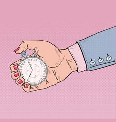 Pop art female hand holding stopwatch vector