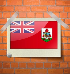 Flags bermuda scotch taped to a red brick wall vector