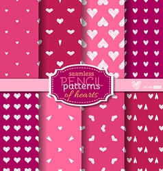 Seamless pencil patterns of hearts vector