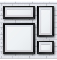 blank picture frame set on brick wall vector image