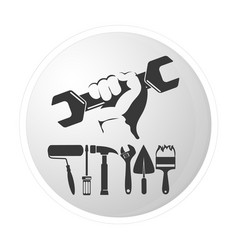 Wrench in hand and other tools vector