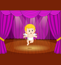 Cute little boy wearing cupid costume on stage vector