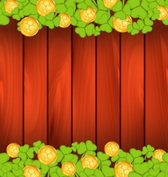 Clovers and golden coins on brown wooden vector image vector image