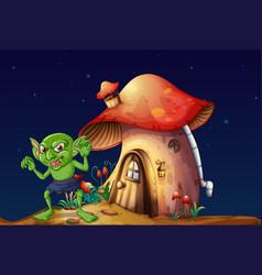 Green elf and mushroom house at night vector