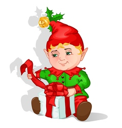 Christmas elf packing gift vector image vector image
