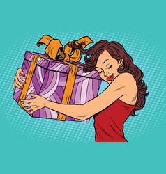 Beautiful young woman hugging gift box vector