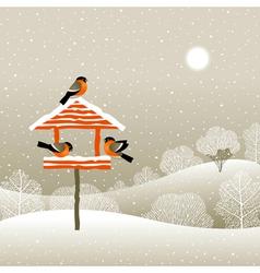 Birdfeeder in winter forest vector