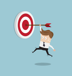 Businessman hanging arrow on target vector
