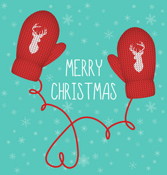 Red knitted mittens with silhouette reindeer vector